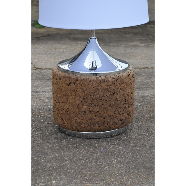 An Iconic Mid-Century Modern design lamp in Chrome and Cork by Laurel. Mirrored chrome tops a cork base, circa 1960's....