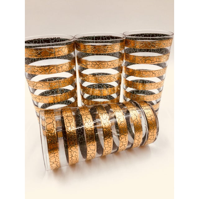This set of 4 highball glasses by Culver is adorned with bands of 22k gold in a crackle finish. If Hollywood glam is more...