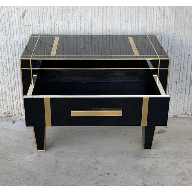 About New pair of mirrored nightstands in black mirror and chrome. Beautiful pair of nightstands with mirrored finished...