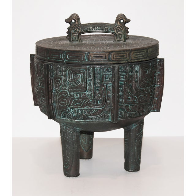 """Metal ice bucket with a stainless steel liner. Patina Verdigris finish. Marked """"Made in Taiwan"""" on the bottom."""