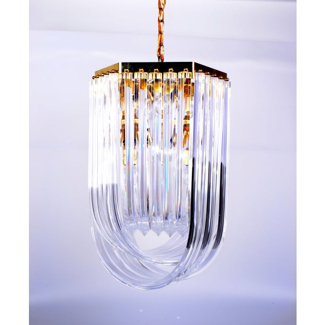 A large, Mid Century Modern lucite ribbon chandelier with canopy. Wired for the U.S. and in excellent working condition,...
