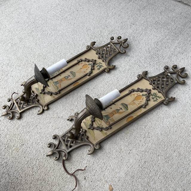 Darling and unique pair of brass wall light candle sconces with hand painted panel. Brass is heavily tarnished and a small...