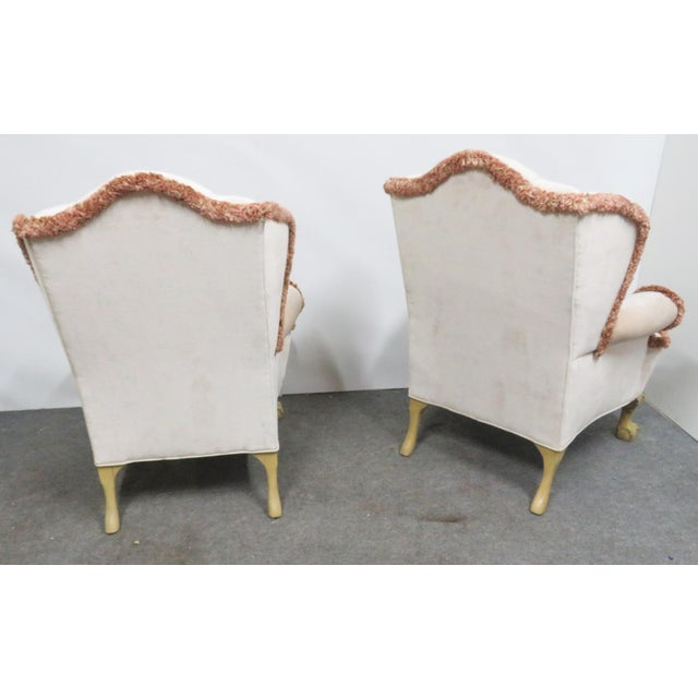 Beige/Cream upholstered with tufted back, Brown/Red accenting fringe. Cream painted ball and claw feet with shell motif at...