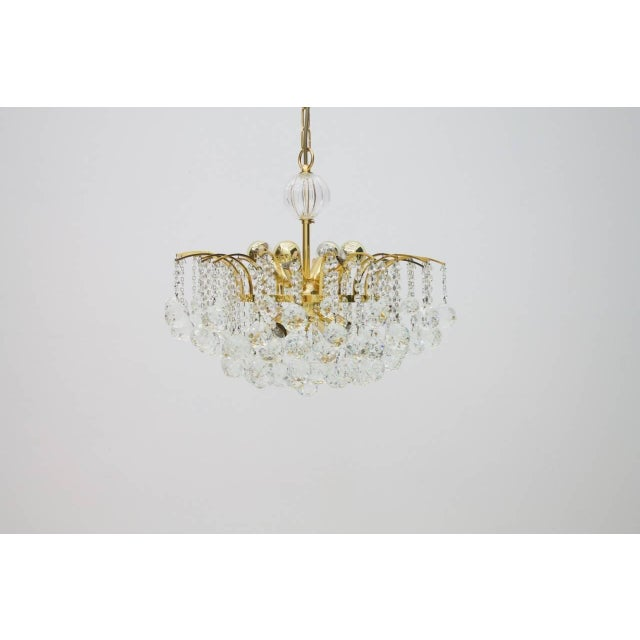 Christoph Palme chandelier in gilded brass and crystal glass from the late 1970s in an excellent condition. For eight...