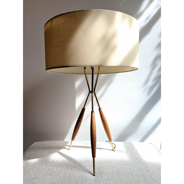 Gerald Thurston for Lightolier. Pair of chic tripod table lamps. Unmarked but authentic. New silk on shades which matches...