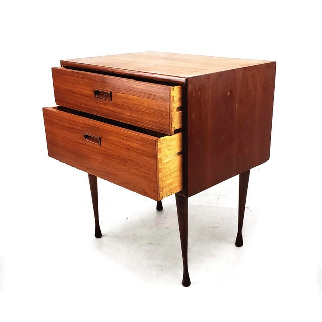 Mid century Danish modern teak two drawer table. The table is in great vintage condition with some minor wear and tear...