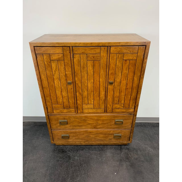 A campaign style gentleman's chest by Drexel Heritage of North Carolina, USA. Two large lower dovetail drawers plus a...