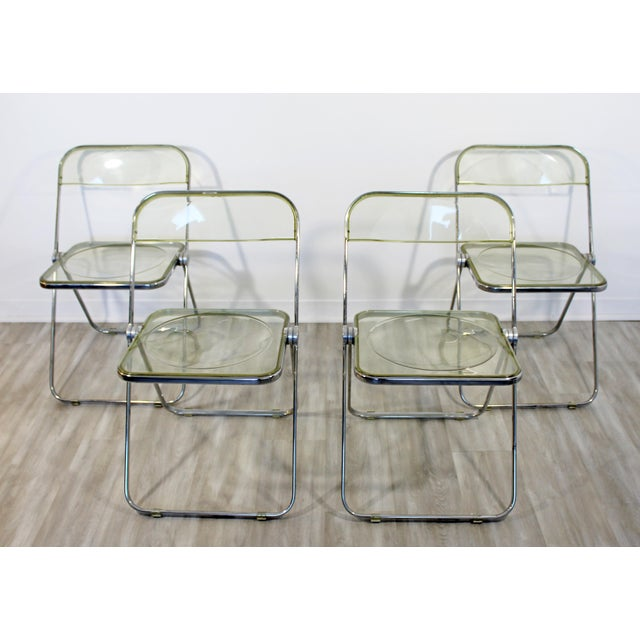 For your consideration is a fantastic set of four folding side chairs, made of chrome and lucite, by Castelli, made in...
