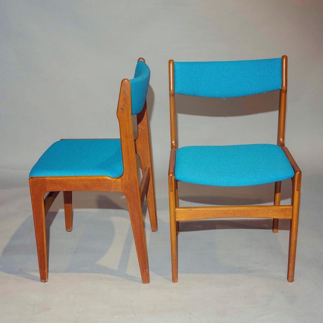 """Mid-Century curated set of 4 teak dining chairs with new maharam blue fabric. 1960's Danish. Dimensions: W19"""" x D18"""" x..."""