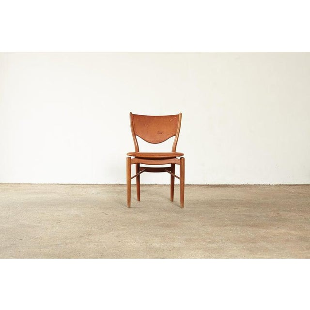 Finn Juhl BO 63 chair, designed in 1949 and manufactured by Bovirke, Denmark. Teak wood with seat and back upholstered in...