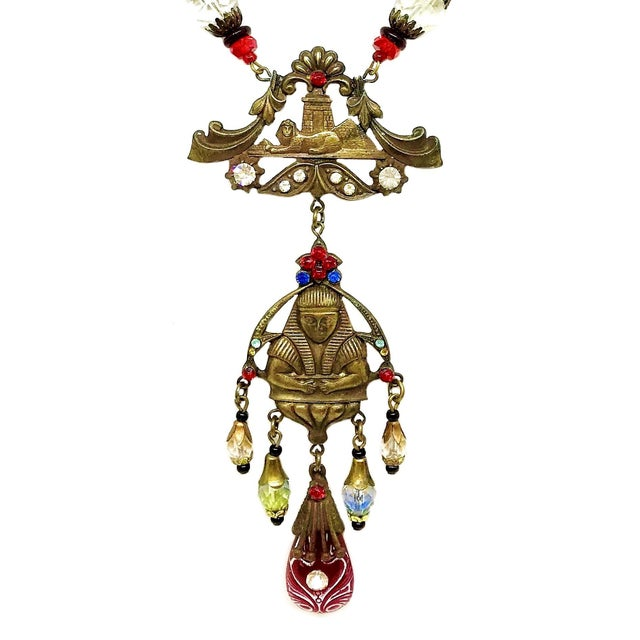 Circa 1920s to 1930s Czech Egyptian Revival large, chunky brass link necklace embellished with clear, red and black glass...