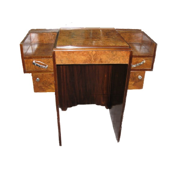 A French Modernist parquetry inlaid walnut desk or vanity. Highly architectural yet small scaled and adhering to the...