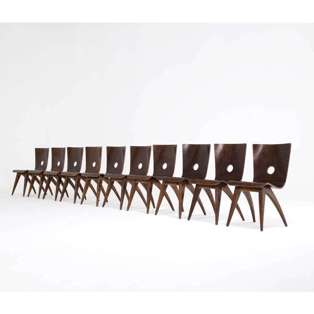 Beautiful swooping set of 8 rare C.J. Van Os Culemborg Bent Plywood Dining Chairs with curved seat and arched legs. In...