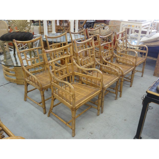 Set of 8 Island Style Geometric Bamboo Dining Chairs . They have cane seats & loose upholstered cushions. The set consists...