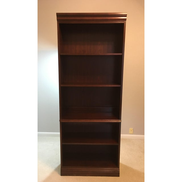 Wood bookcase by Hooker Furniture. Five open shelves with three adjustable. Well maintained in like new condition. Hooker...
