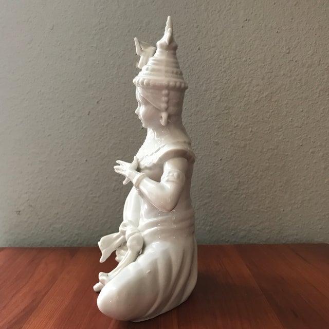 Beautiful vintage blanc de chin Thai Siam figurine. White with a slightly bluish-grey tint.