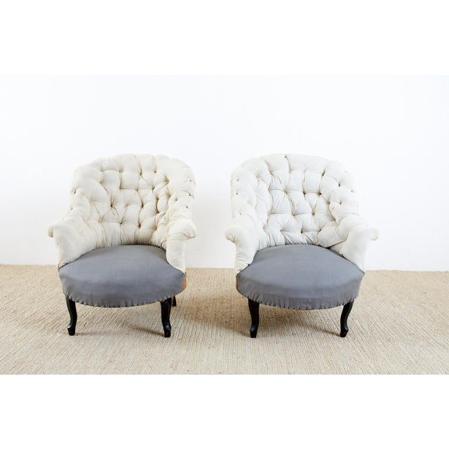 Charming pair of 19th century French Napoleon III period slipper chairs having a deconstructed style. The chairs feature a...
