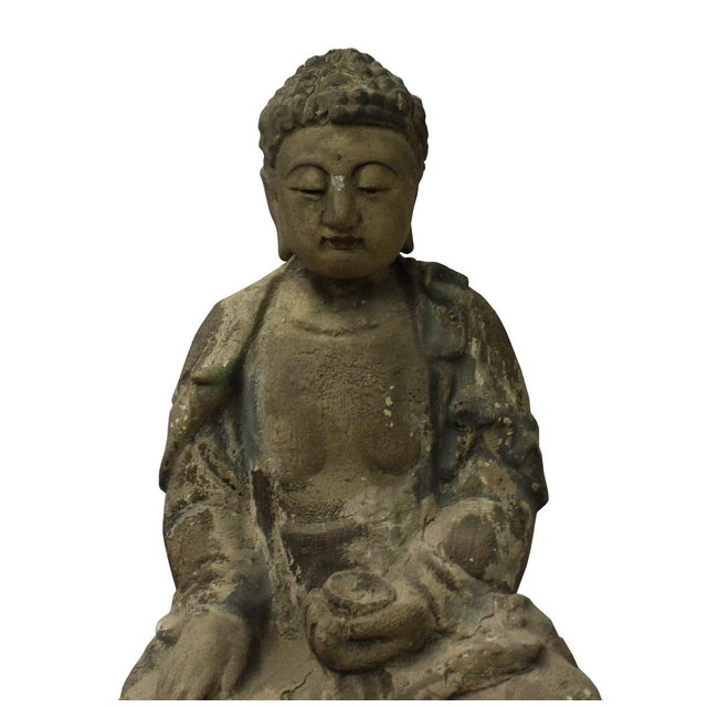 This is a Chinese decorative wooden Sitting Buddha statue. It is finished in vintage rustic look. There are detail motif...