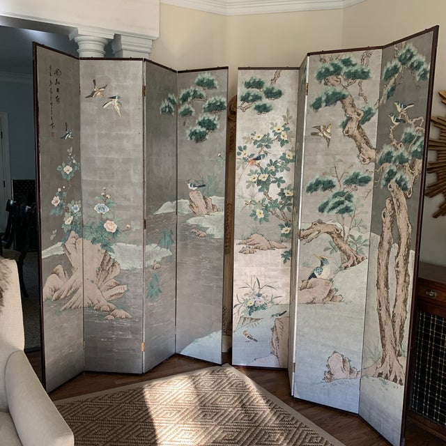 Stunning eight panel silver leaf Chinoiserie folding screen. Beautifully painted springtime chinoiserie featuring birds,...