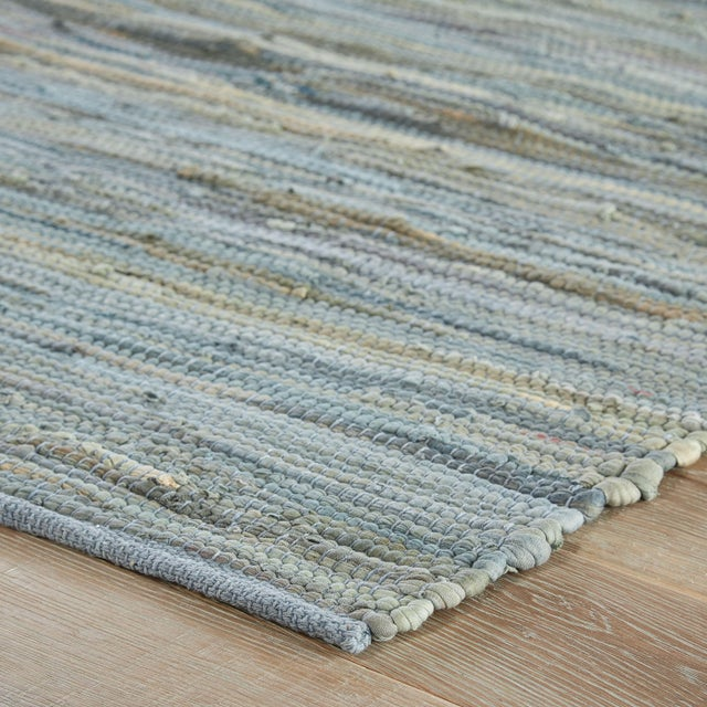 This hand-loomed area rug showcases a chic colorway and casual coastal charm. The cotton and recycled material blend lends...