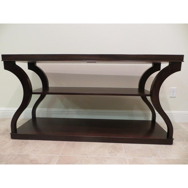 Beautiful dark sable finish console crafted from zebra wood veneer with Indonesian mahogany solids. The top features four-...