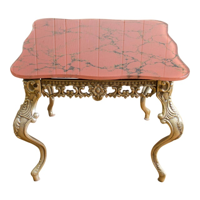 Hollywood Regency Chippendale style side tables feature ornate cabriole brass legs with a thick scalloped glass top that...