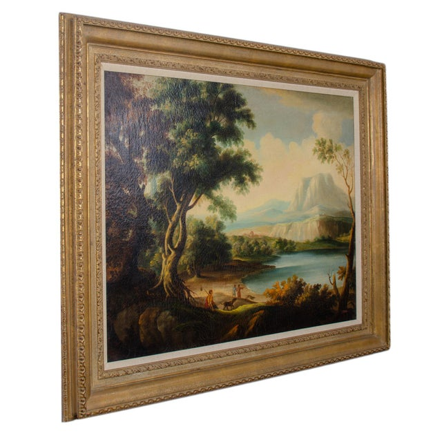An Italianate landscape oil on canvas by D. Buson. Three figures with dogs overlooking a lake with mountains in the...