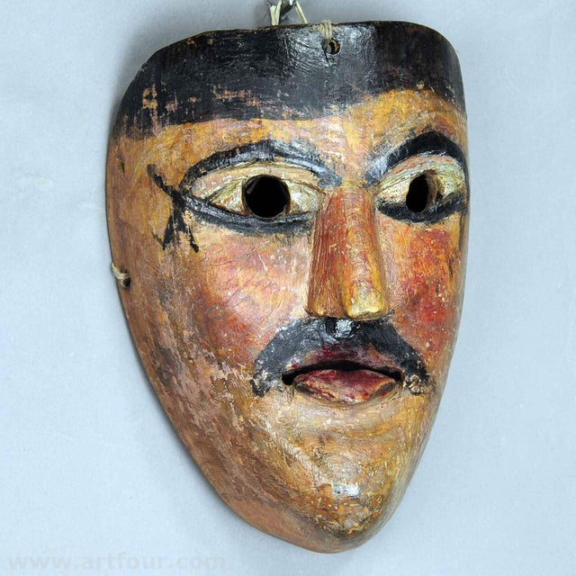 an antique wooden carved carnival mask from the region of South Tyrol. these masks are used in Austria, South Germany and...