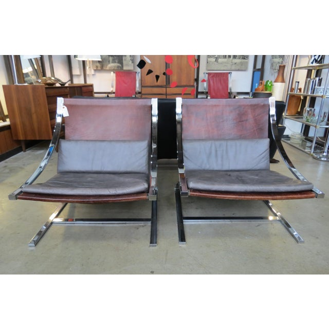 Vintage MID CENTURY MODERN Pair RARE Leather Sling Chairs designed by Paul Tuttle in 1964 in two tone leather and Chrome....