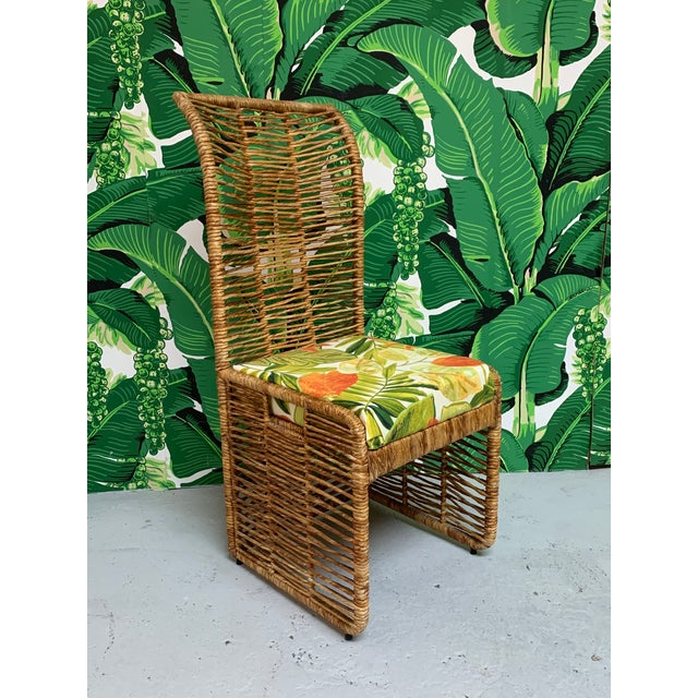 Unique set of 6 rattan rope wrapped dining chairs upholstered in a tropical palm leaf print. Steel frame construction,...