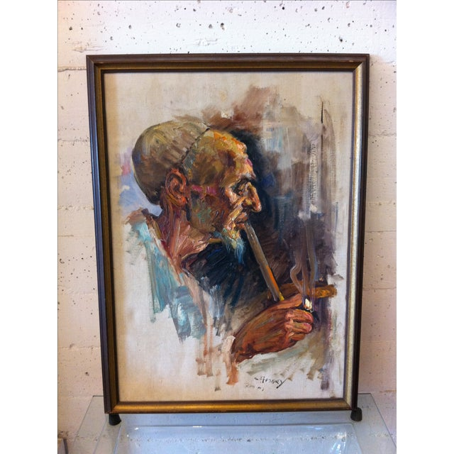 This stunning painting depicts a Middle Eastern man solemnly smoking his pipe as the smoke lifts above him, while darks...