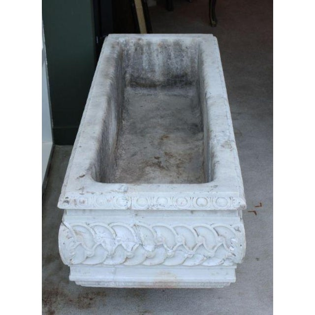 A beautifully carved white marble jardiniere/planter made during the 19th century in France or Italy. As there is no drain...