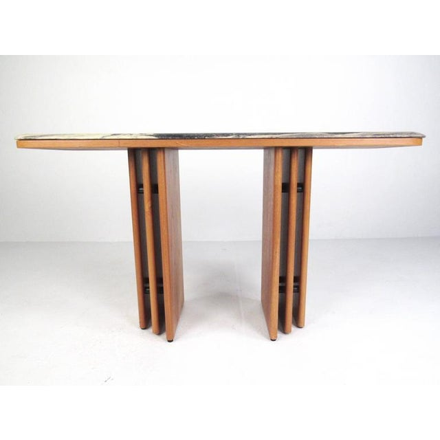 This vintage Danish teak console table by Bendixen features a sleek and stylish flared base topped with a stunning marble....
