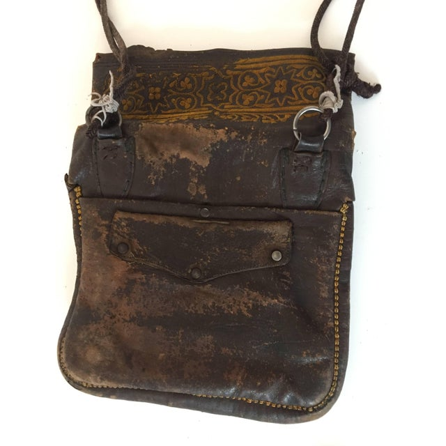 Old leather African Moroccan satchel bag with flap decorated with tribal embroideries. Hand-tooled in Marrakech, this is...