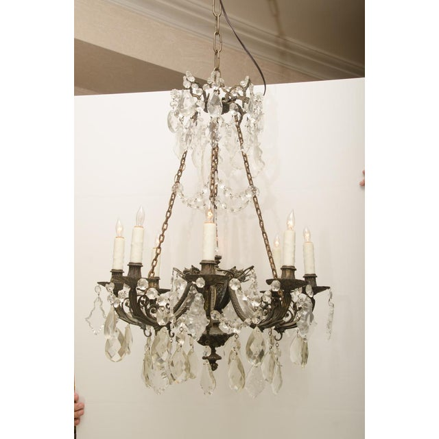 Beautifully detailed iron and crystal 8-lite converted gas light chandelier in excellent condition