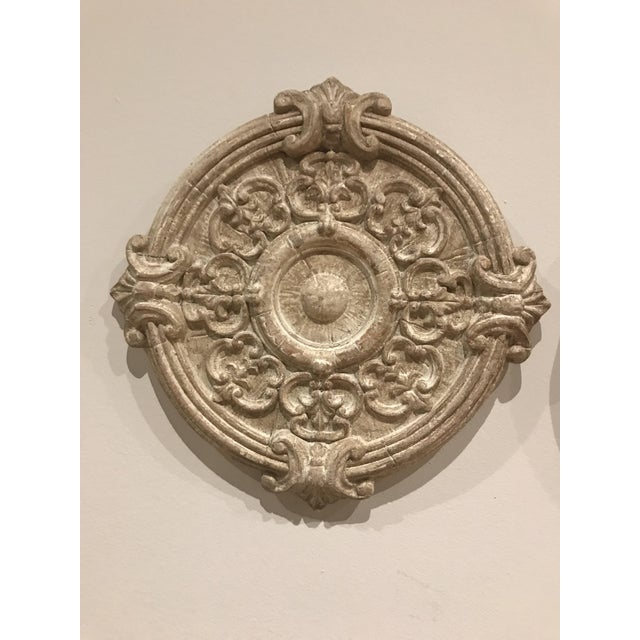 This is a set of 3 round sculptural wall objects that can be used to accent a space. The pieces are made of resin and were...