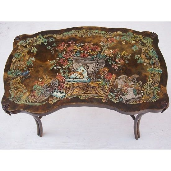 Signed Philip & Kelvin collectible coffee table.Pompadour Floral Model that has colorful etched enamel surface. This low...
