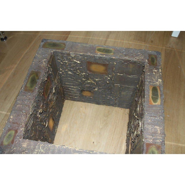 """A """"goop"""" style coffee table. It is not signed but done in a resin applied to wood base. There are also some copper or..."""