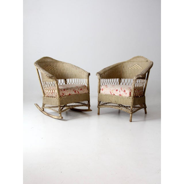 This is an antique wicker chair and rocker set. It includes a barrel chair and rocking chair. Woven wicker and reed...