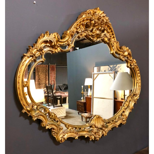 Vintage heavy duty LARGE gold mirror. Unique shape, perfect statement piece for above a mantel or entry way! Excellent...