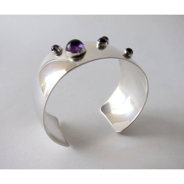 Sterling silver cuff bracelet featuring five amethyst cabochon stones created by Niels Erik From of Denmark. Cuff measures...