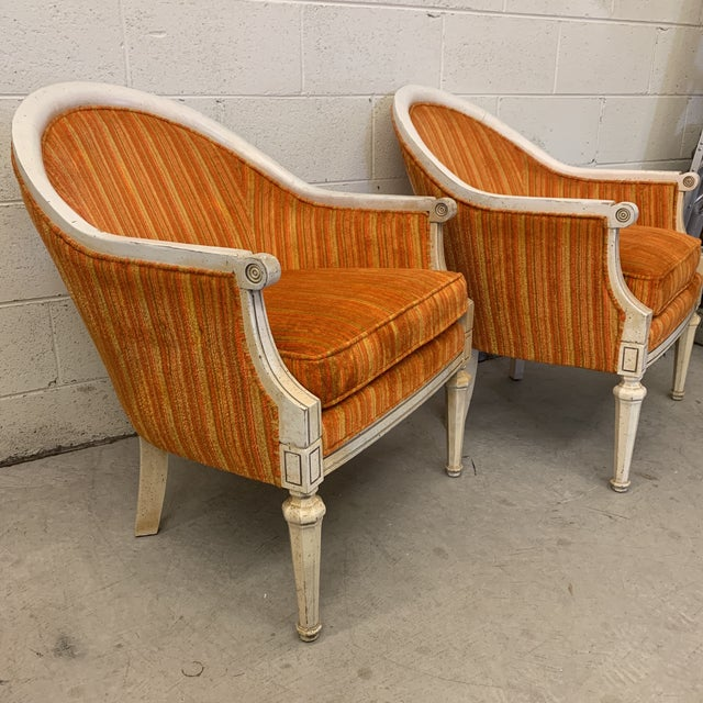 Yes, the orange is THAT orange. Beautiful chenille fabric in bright Sunkist orange and yellow stripe. Great pair of French...
