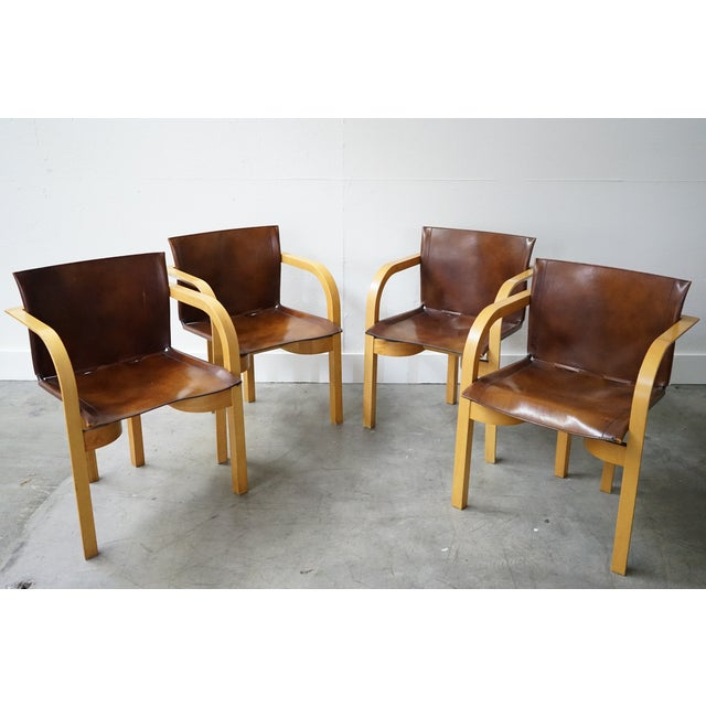 Take a look at this set of four mid-century arm chairs with elegant and simple lines that are typical of mid-century...