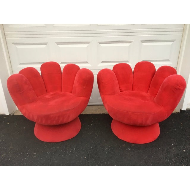 Two red plush velvet like hand chairs that swivel! The chairs are a set but I will consider separating. They are for the...