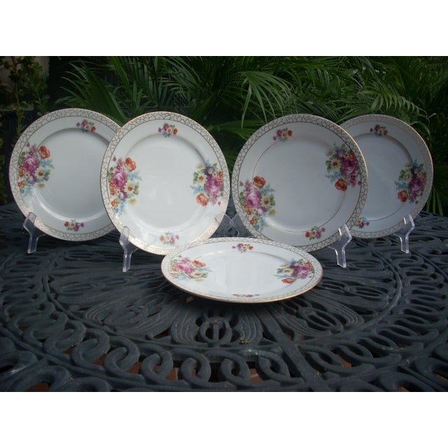 SGK China dessert plates pre 1953. Gold crackle design edge frames traditionally styled multi-color clusters of blossoms...