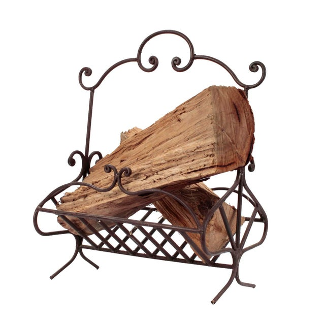 19th century intricately hand wrought iron log holder from France. Has a full 12 scrolled finished ends including two at...