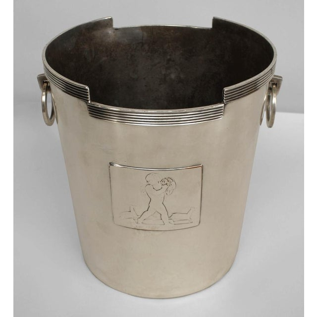 American Art Deco chrome plated champagne bucket with geometric shape & fluted trim with ring handles; panel with figure &...
