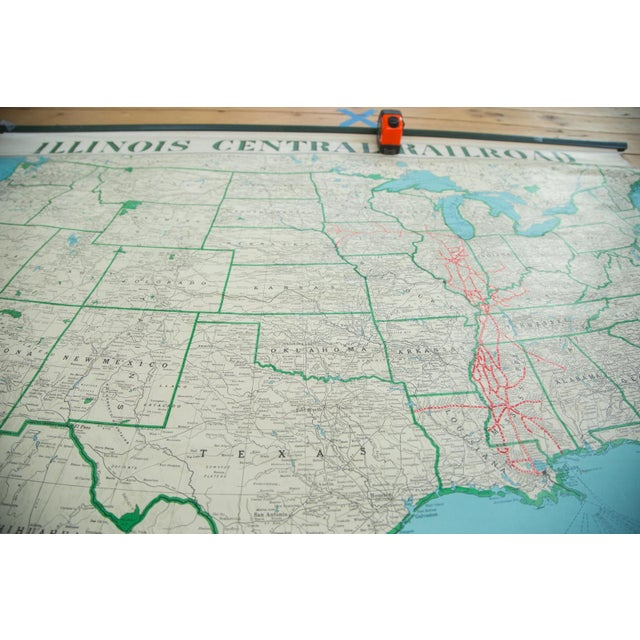 Vintage 1950s mid century pull down map that is rather hard to find, depicting United States with Illinois Central...