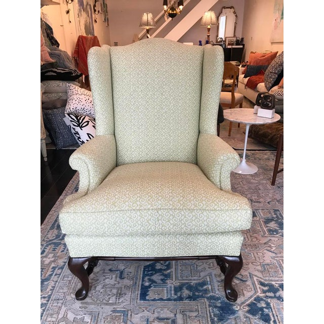 Lovely George III wingback chair with down fill. Fantastic green Fortuny style upholstery with complementary fabric on...