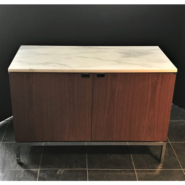Original labeled walnut 37 inch credenza with two doors and four adjustable interior shelves. Can be used as a room...